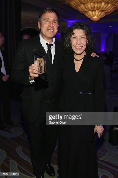 Director David O Russell and actress Lily Tomlin attend AARP's Movie For GrownUps Awards at the Beverly Wilshire Four Seasons Hotel on February 8...
