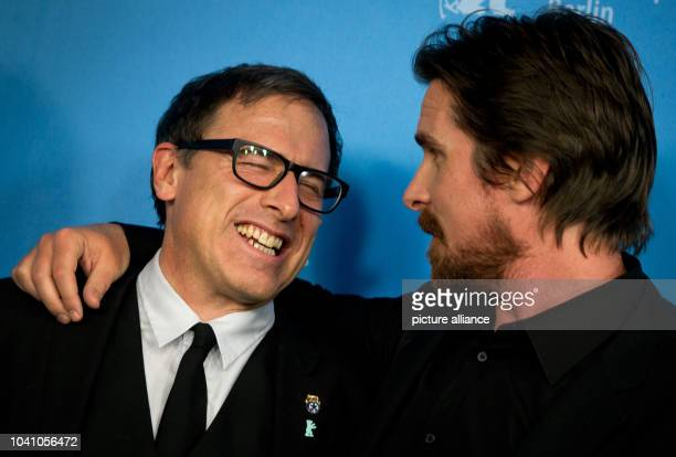 US director David O Russell and British actor Christian Bale pose during the photocall for 'American Hustle' at the 64th annual Berlin Film Festival...