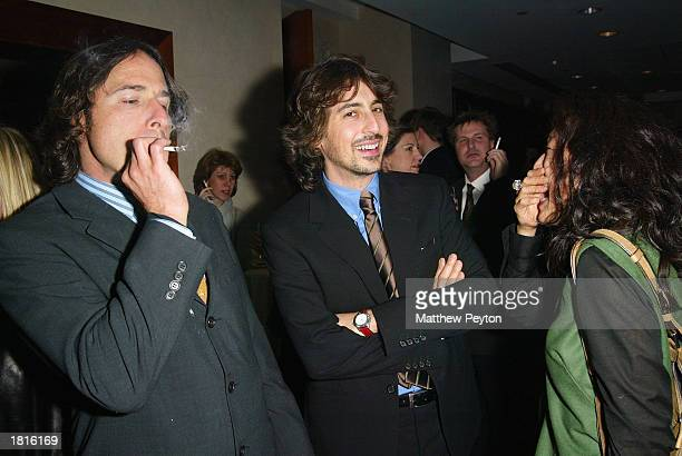 Director David O Russell enjoys a smoke with director Alexander Payne and wife Sandra Oh at the after party for the MOMA Celebration of the Films of...