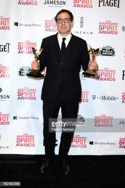 Director David O Russell poses with the Best Director and Best Screenplay awards for 'Silver Linings Playbook' in the press room during the 2013 Film...