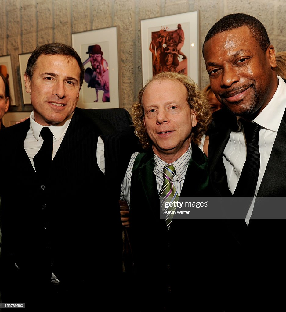 Director David O. Russell, producer Bruce Cohen and actor Chris Tucker pose at the after party for a screening of The Weinstein Company's 'Silver Lining's Playbook' at the Academy of Motion Picture Arts and Sciences on November 19, 2012 in Beverly Hills, California.