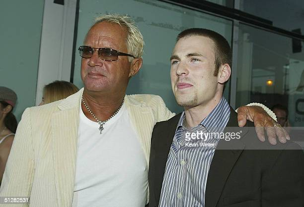 Director David R Ellis and actor Chris Evans arrive at the premiere of New Line Cinemas Cellular on September 9 2004 at the Cinerama Dome in Los...