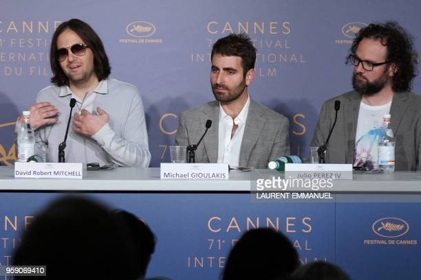 US director David Robert Mitchell speaks as US director of photography Mike Gioulakis and US editor Julio Perez IV listen during a press conference...