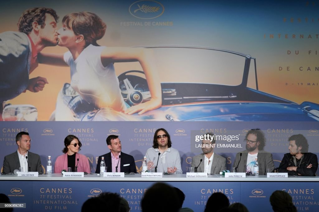 US director David Robert Mitchell (C) speaks as (From L) US producer Jake Weiner, US producer Adele Romanski, US producer Chris Bender, US director of photography Mike Gioulakis, US editor Julio Perez IV and US composer Richard Vreeland, aka Disasterpeace listen during a press conference on May 16, 2018 for the film 'Under the Silver Lake' at the 71st edition of the Cannes Film Festival in Cannes, southern France.