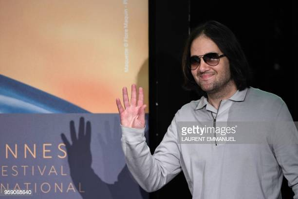 US director David Robert Mitchell waves as he arrives on May 16 2018 at a press conference for the film 'Under the Silver Lake' at the 71st edition...