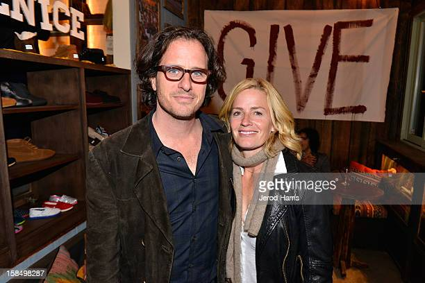 Director Davis Guggenheim and actress Elisabeth Shue attend the Grand Opening of TOMS official flagship store on Venice's Abbot Kinney Blvd on...