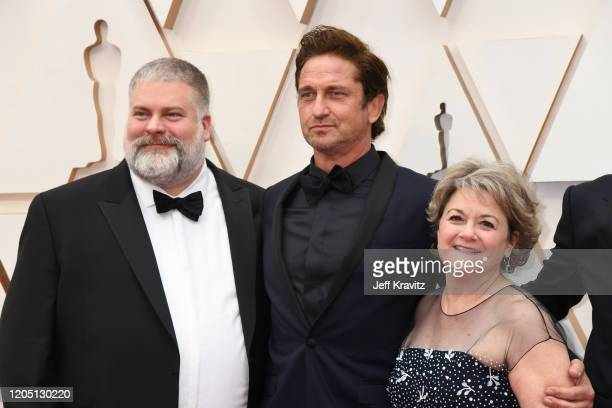 Director Dean DeBlois Gerard Butler and producer Bonnie Arnold attend the 92nd Annual Academy Awards at Hollywood and Highland on February 09 2020 in...