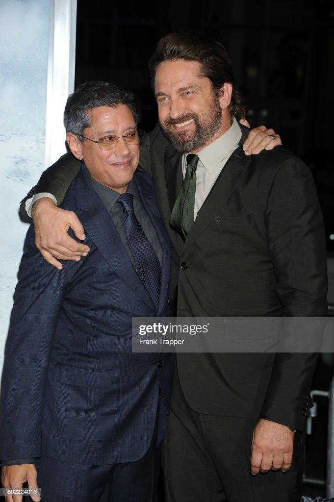 Director Dean Devlin and actor Gerard Butler attend the premiere of Warner Bros. Pictures' 'Geostorm' on October 16, 2017 at the TCL Chinese Theater in Hollywood, California.