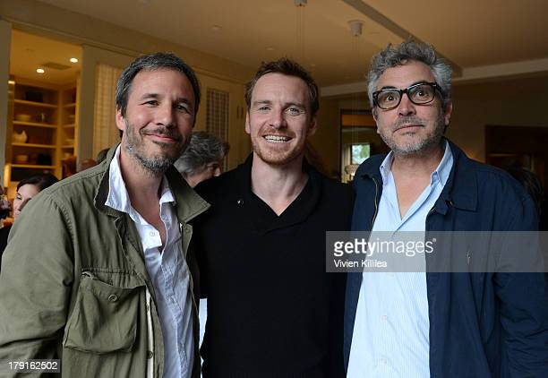 Director Denis Villeneuve actor Michael Fassbender and director Alfonso Cuaron attend the AMPAS party at the 2013 Telluride Film Festival Day 3 on...