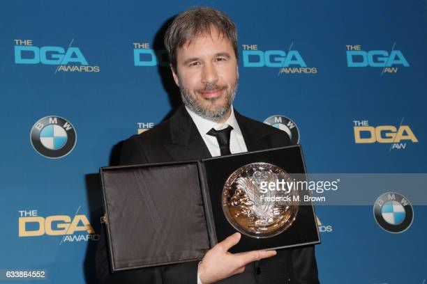 "Director Denis Villeneuve recipient of the Feature Film Nomination Plaque for ""Arrival"" poses in the press room during the 69th Annual Directors..."