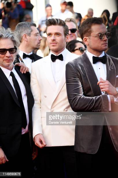 Director Dexter Fletcher Richard Madden and Taron Egerton attend the screening of Rocketman during the 72nd annual Cannes Film Festival on May 16...