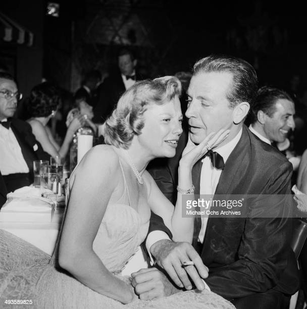 Director Dick Powell and actress June Allyson attend a party in Los Angeles, California.