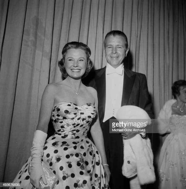 Director Dick Powell and actress June Allyson attend a party in Los Angeles California