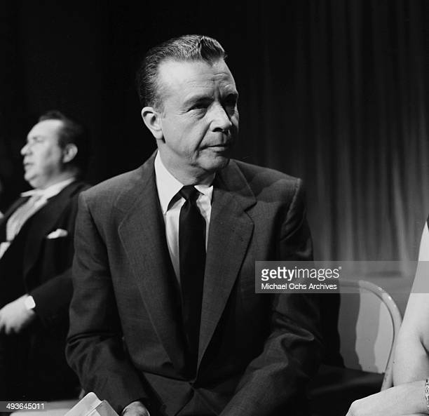 Director Dick Powell attends the Oscar Nominations in Los Angeles California