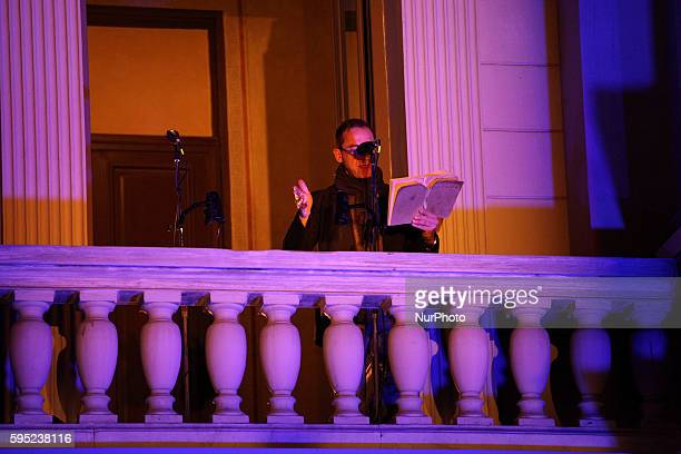 Director Dimitris Lignadis recite o poem on the balcony of National Theatre in Athens on World Poetry Day on Mar 21, 2016