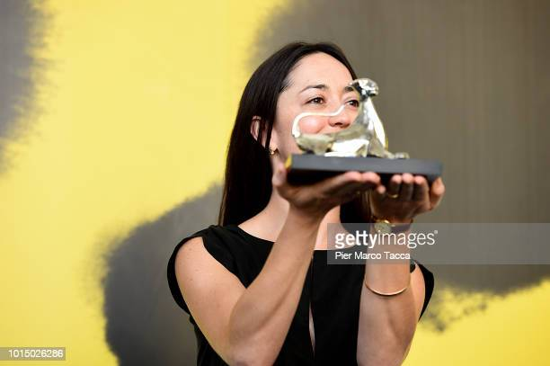 Director Dominga Sotomayor poses with Pardo for the Best Direction of International Competition at the Palmares photocall during the 71st Locarno...
