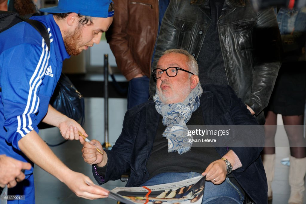 Director Dominique Farrugia signs autographs before 'Sous Le Meme Toit' Premiere at Kinepolis on April 3, 2017 in Lille, France.