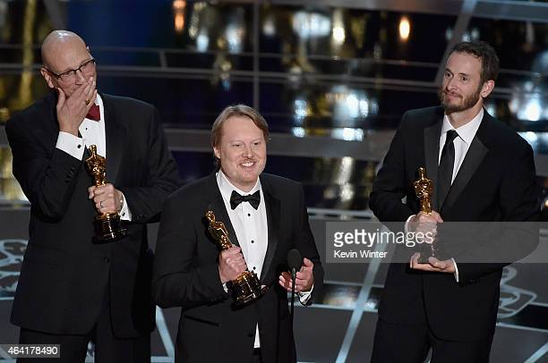 Director Don Hall accepts the Best Animated Feature Award for Big Hero 6 with Chris Williams and Roy Conli onstage during the 87th Annual Academy...