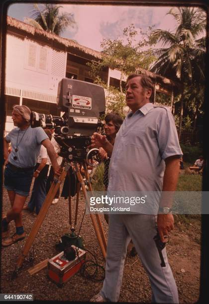 Director Don Taylor stands behind the camera during the filming of The Island of Dr Moreau