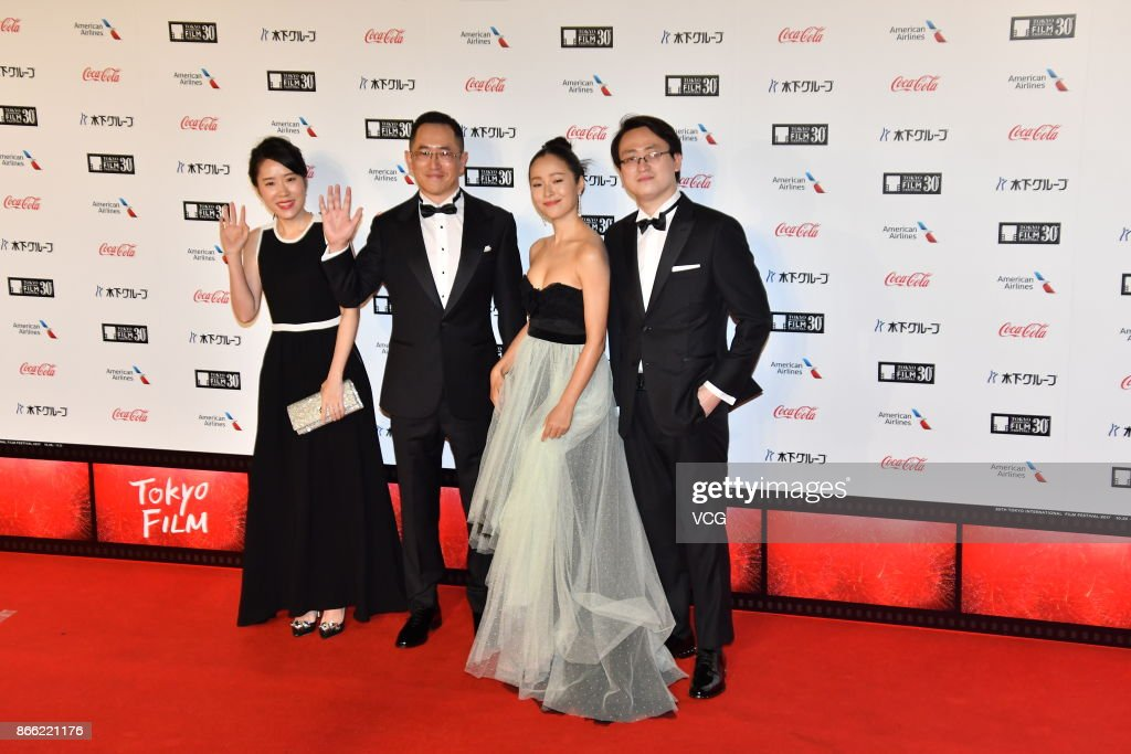 Director Dong Yue (L4) and actress Jiang Yiyan (L3) arrive at the red carpet of the 30th Tokyo International Film Festival at Roppongi Hills on October 25, 2017 in Tokyo, Japan.