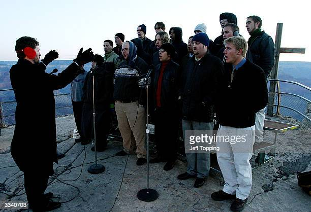 Director Dr Gary Weidenaar conducts the Northern Arizona University Men's Chorale during Easter sunrise service on Mather Point at the south rim of...