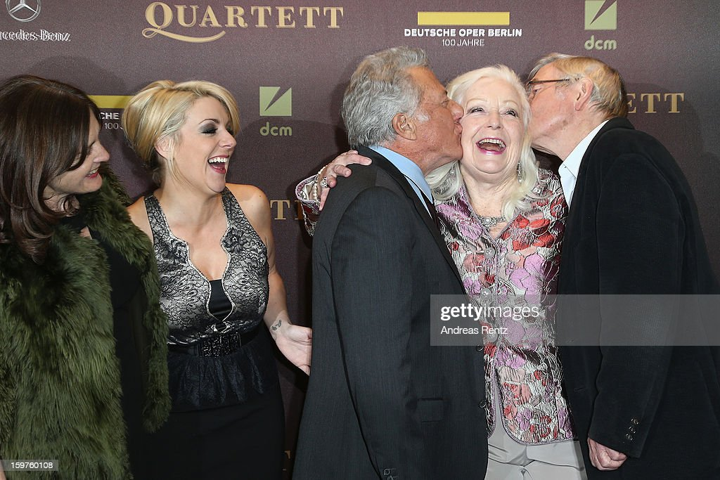 Director Dustin Hoffman (C) and Tom Courtenay (R) kiss Gwyneth Jones (2nd-R) as Sheridan Smith (2nd-L) smiles upon their arrival for the premiere of 'Quartet' at Deutsche Oper on January 20, 2013 in Berlin, Germany.