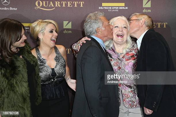 Director Dustin Hoffman and Tom Courtenay kiss Gwyneth Jones as Sheridan Smith smiles upon their arrival for the premiere of 'Quartet' at Deutsche...