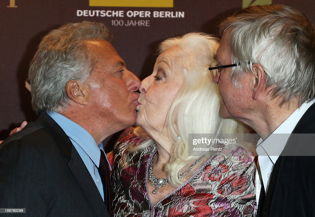 Director Dustin Hoffman (L) and Tom Courtenay (R) kiss Gwyneth Jones (C) upon their arrival for the premiere of 'Quartet' at Deutsche Oper on January 20, 2013 in Berlin, Germany.
