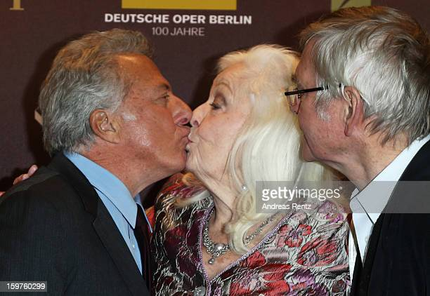 Director Dustin Hoffman and Tom Courtenay kiss Gwyneth Jones upon their arrival for the premiere of 'Quartet' at Deutsche Oper on January 20 2013 in...