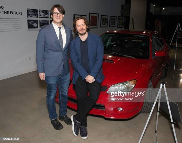 Director Edgar Wright and LA Times reporter Mark Olsen pose with a Subaru car at the 'Cars Arts Beats A Night Out With 'Baby Driver'' event at the...