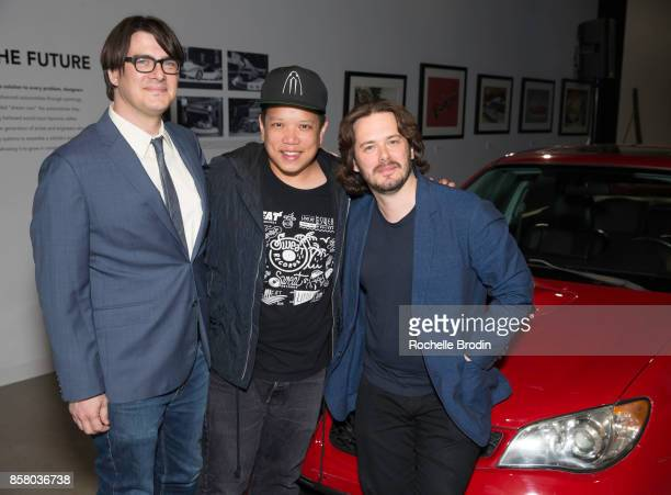 Director Edgar Wright DJ Kid Koala and reporter Mark Olsen pose with a Subaru car at the 'Cars Arts Beats A Night Out WithÊ 'Baby Driver'' event at...