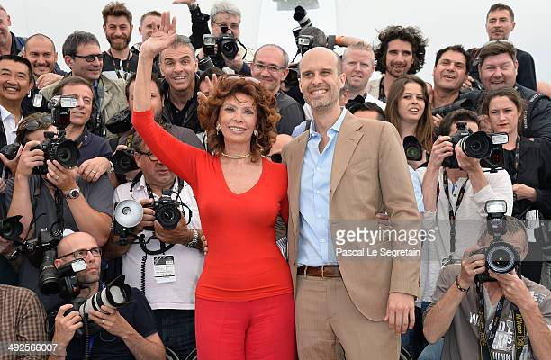 Director Edoardo Ponti and Sophia Loren attend a photocall to present Cannes Classics at the 67th Annual Cannes Film Festival on May 21 2014 in...