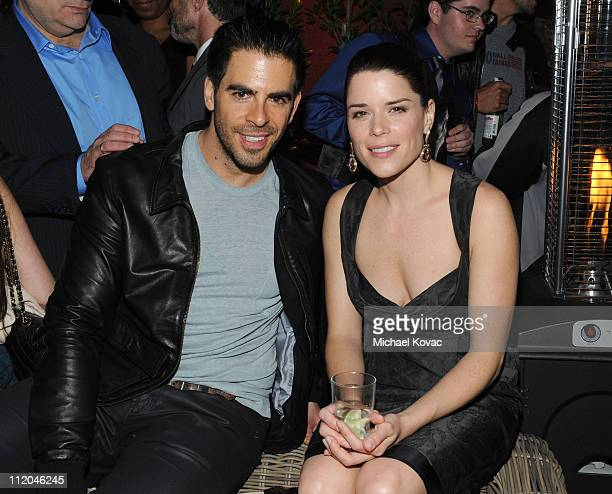 Director Eli Roth and actress Neve Campbell attend the Scream 4 premiere after party presented by AXE Shower held at The Redbury Hotel on April 11...
