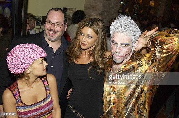 Director Eli Roth and Lions Gate Films executive Peter Block mingle with actors Jordan Ladd and Cerina Vincent at the afterparty for the premiere of...