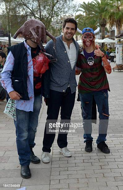 Director Eli Roth poses with fans during the 46th Sitges Film Festival on October 12 2013 in Sitges Spain