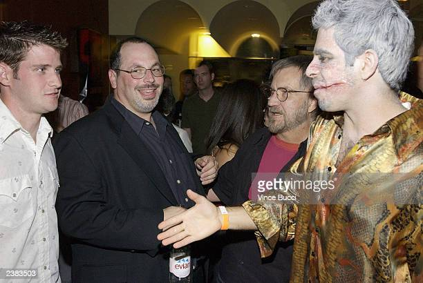 Director Eli Roth wears make up as he greets director Richard Kelly at the afterparty for the premiere of the film Cabin Fever on August 8 2003 at...
