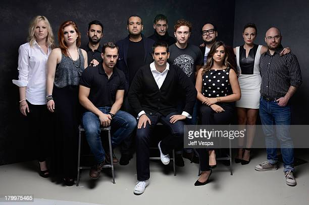 Director Eli Roth with the cast and crew of 'The Green Inferno' pose at the Guess Portrait Studio during 2013 Toronto International Film Festival on...