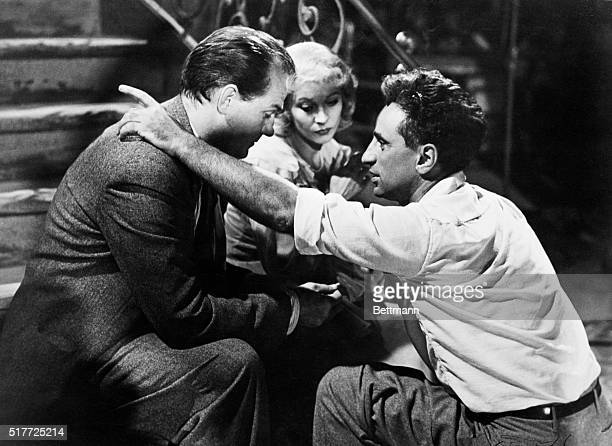 Director Elia Kazan gives instructions to actors Karl Malden and Vivien Leigh before shooting a scene from the movie A Streetcar Named Desire.
