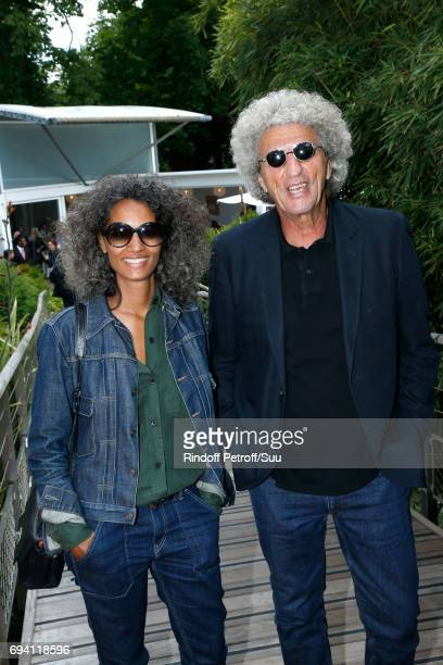 Director Elie Chouraqui and his wife Isabel Sulpicy attend the 2017 French Tennis Open Day Thirteen at Roland Garros on June 9 2017 in Paris France