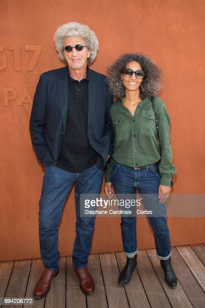 Director Elie Chouraqui and his wife Isabel Sulpicy attend the French Tennis Open 2017 Day Thirteen at Roland Garros on June 9 2017 in Paris France