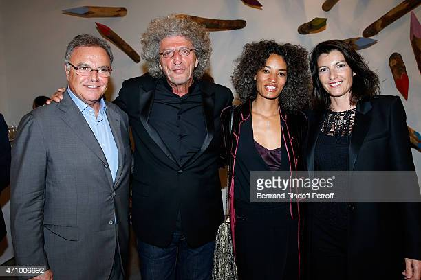 Director Elie Chouraqui and his wife Isabelle standing between Alain Afflelou and his wife Christine attend the 'A Moment of Reconstruction' Informal...