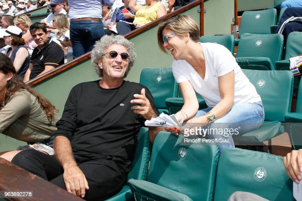 Director Elie Chouraqui and journalist Benedicte le Chatelier attend the 2018 French Open Day Four at Roland Garros on May 30 2018 in Paris France