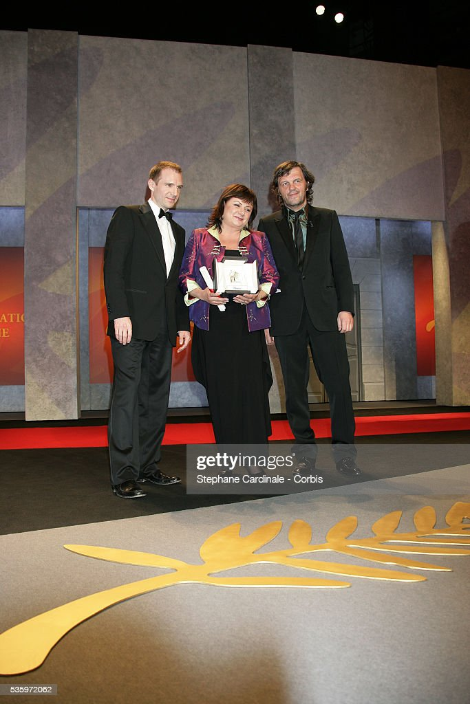 Director Emir Kusturica, actor Ralph Fiennes and actress Hanna Laslo with her award for 'Best Female Actress' at the closing ceremony of the 58th Cannes Film Festival.