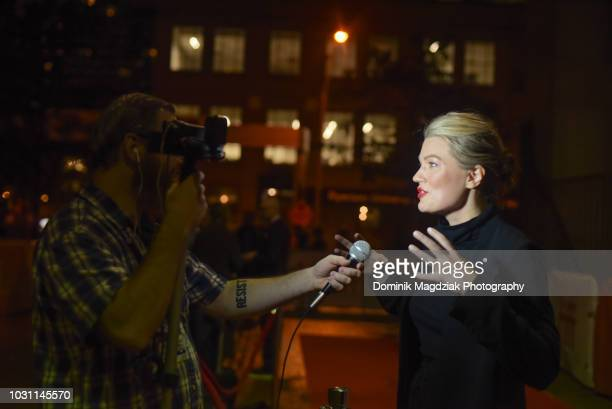 Director Emma Tammi being interviewed during the Midnight Madness red carpet premiere for The Wind during the Toronto International Film Festival at...