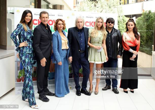 Director Enrico Vanzina and cast members Romina Pierdomenico Ezio Greggio Paola Minaccioni Martina Stella Ricky Memphis and Maria Luisa Jacobelli...