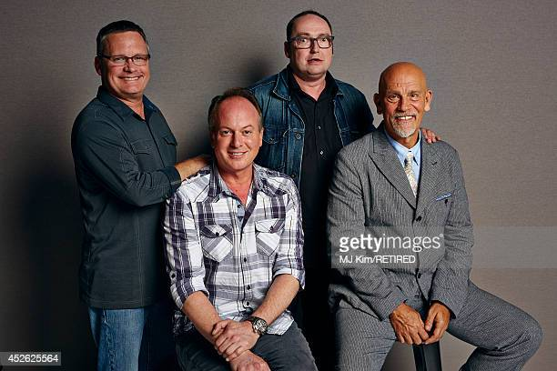 Director Eric Darnell actor/director Tom McGrath director Simon J Smith and actor John Malkovich pose for a portrait at Getty Images Portrait Studio...