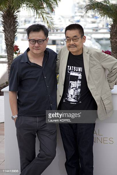 Director Eric Khoo and actor Yoshihiro Tatsumi attend the 'Tatsumi' photocall at the Palais des Festivals during the 64th Cannes Film Festival on May...