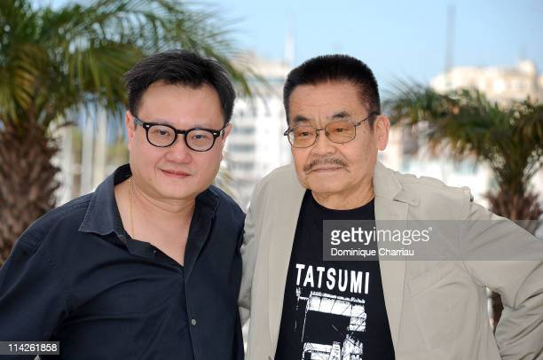 "Director Eric Khoo and daughtsman and writer Yoshihiro Tatsumi attends the ""Tatsumi"" Photocall at the Palais des Festivals during the 64th Cannes..."