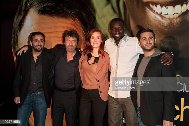 Director Eric Toledano actors Francois Cluzet Audrey Fleurot and Omar Sy and director Olivier Nakache attend the Paris premiere of 'Intouchables' at...