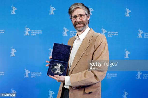 Director Esteban Arrangoiz poses with the Silver Bear Jury Prize backstage after the closing ceremony of the 67th Berlinale International Film...